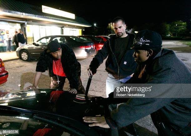 Suffolk County Police officers from the antigang unit check question two suspects about marijuana in a local shopping mall on eastern Long Island...