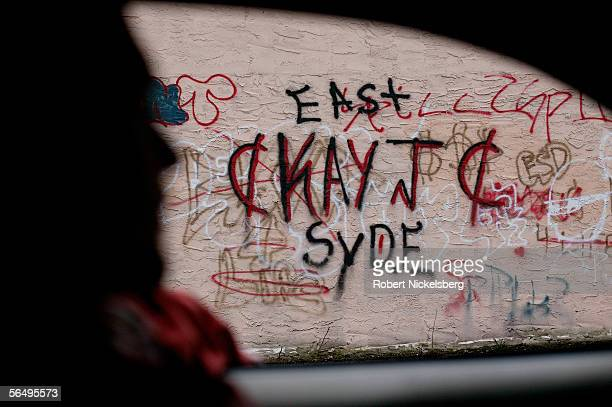 Suffolk County Police officers from the antigang unit check walls for gang graffiti behind local shopping malls October 27 2005 in Brentwood New York...
