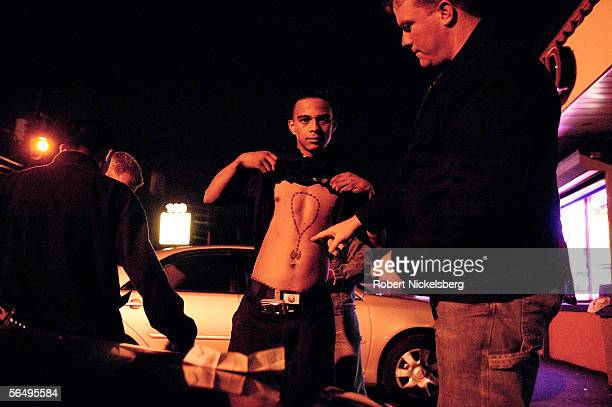 Suffolk County Policemen from the antigang unit check identity papers and tattoos of possible gang members of Mara Salvatrucha 13 or MS13 October 27...