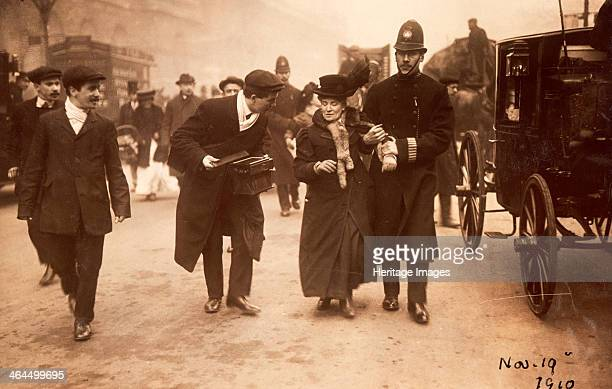 Suffragette being arrested 19th November 1910 A tall policeman leads a rather shorter suffragette away holding on to her arm Many suffragettes were...