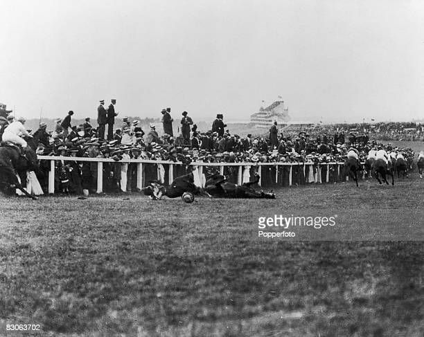 Suffragette Emily Davison is fatally injured as she steps in front of King George V's horse 'Amner' at the Epsom Derby 4th June 1913