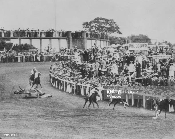 Suffragette Emily Davison throwing herself under the King George V's horse Anmer at the Epsom Derby
