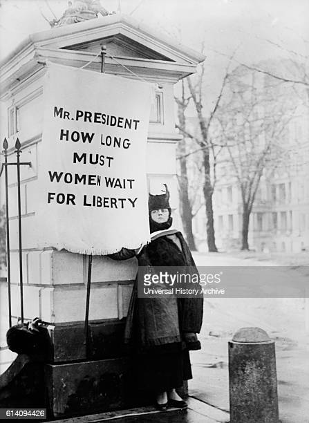 Suffragette Holding Protest Banner 'Mr President How Long Must Women Wait for Liberty' Washington DC USA circa 1917