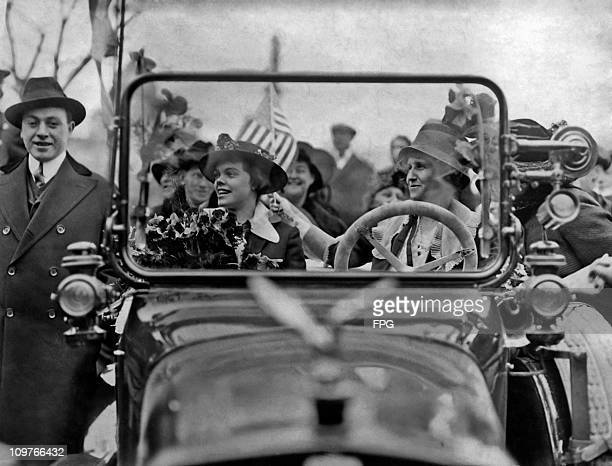 Suffragettes Nell Richardson and Alice S Burke driving a car at a rally in New York in 1915