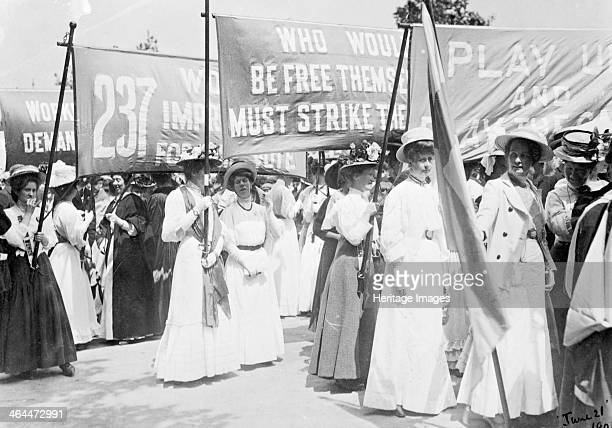 Suffragettes on the Euston Road procession carrying banners to Women's Sunday London 21st June 1908 The marching women were accompanied by drums and...
