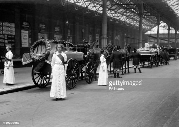 Suffragettes stand on guard over the coffin of the Derby Suffragette Emily Davison at Victoria Station