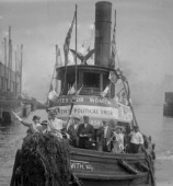 Suffragist ride in a tugboat adorned with slogans Jersey City New Jersey 1913