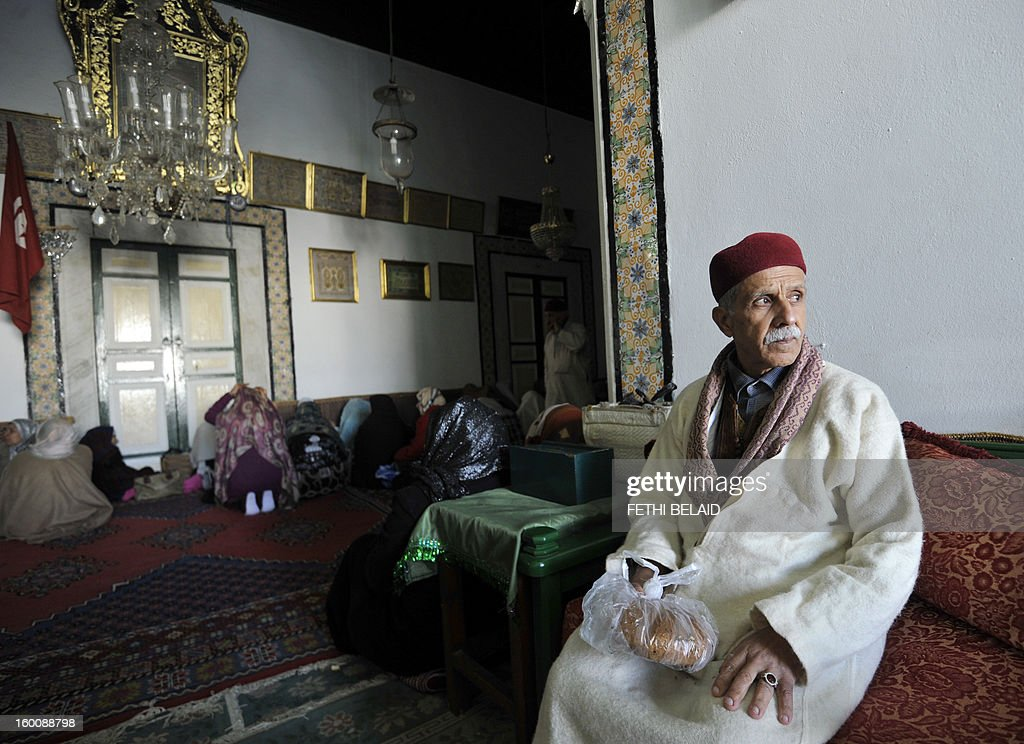 A Sufi man sits during his visit to the shrine of Sidi Belhassen Chedly following his weekly rituals on January 26, 2013, in Tunis. Tunisia's government has promised to implement 'emergency' measures to protect Sufi Muslim mausoleums, which have been targeted in a number of suspected hardline Islamist attacks, the culture minister said. AFP PHOTO / FETHI BELAID Sufi leaders soretent the mausoleum of Sidi Bellahsen Chadly after having completed their weekly ritual on January 26, 2013 in Tunis. The Tunisian government has promised to day measures 'emergency' to protect Sufi shrines covered by dozens of attacks, an announcement Saturday called 'positive' by the Union but tradive Sufi Tunisia accuses Salafi factions of these rampages .