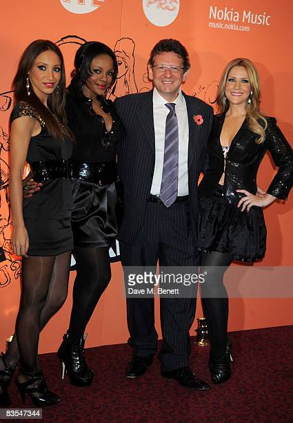 Sugababes Amelle Berrabah Keisha Buchanan and Heidi Range with Lucian Grainge arrive at the Music Industry Trusts' Awards 2008 at the Grosvenor House...
