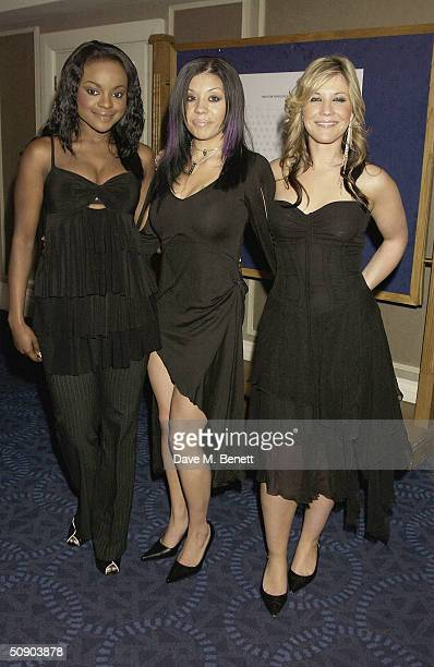 Sugababes bandmates Keisha Buchanan Mutya Buena and Heidi Range attend the 49th annual 'Ivor Novello Awards' honouring the best songs and film scores...