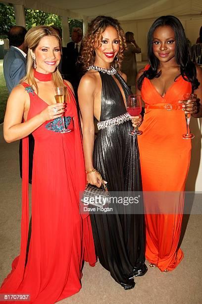 Sugababes Heidi Range Amelle Berrabah and Keisha Buchanan arrive at the dinner in honour of Nelson Mandela celebrating his 90th birthday at Hyde Park...