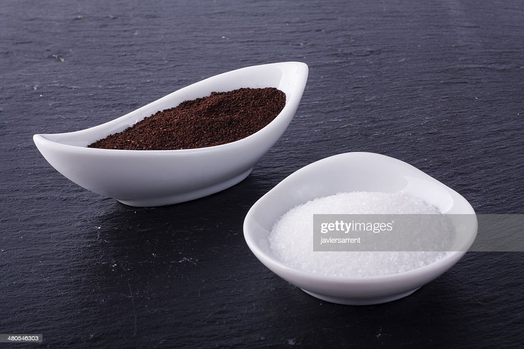 Sugar and coffee in two little white ceramic bowls : Stock Photo