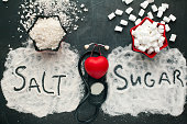 Sugar and salt brings harm to the heart, concept of healthy lifestyle without sugar and salt.
