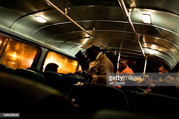 Sugar cane cutters get on a bus before going to work on a field near Florida on 25 May 2012 in Florida Valle del Cauca Colombia The Cauca River...