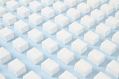 Sugar cubes pattern on blue background