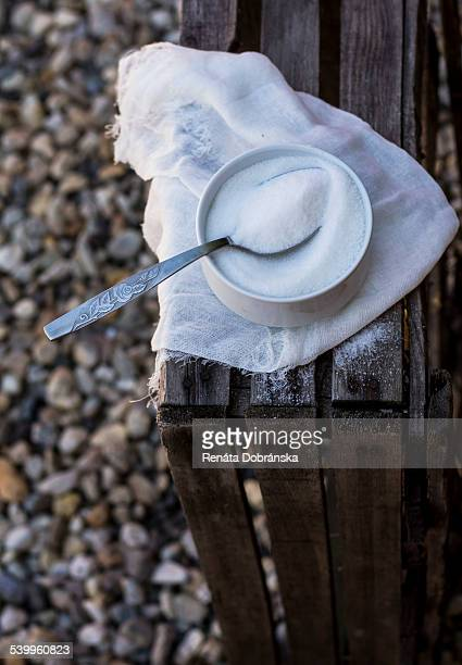 Sugar in a bowl on a wooden crate