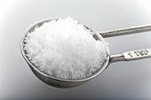 Sugar in measuring spoon