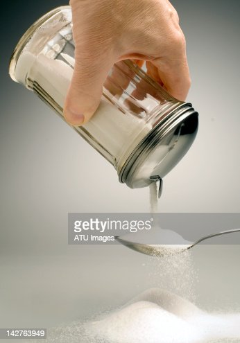 Sugar pouring over a spoon