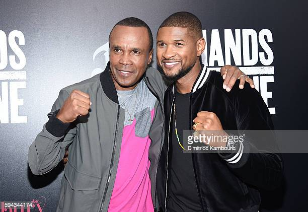 Sugar Ray Leonard and Usher attend the 'Hands Of Stone' US premiere at SVA Theater on August 22 2016 in New York City