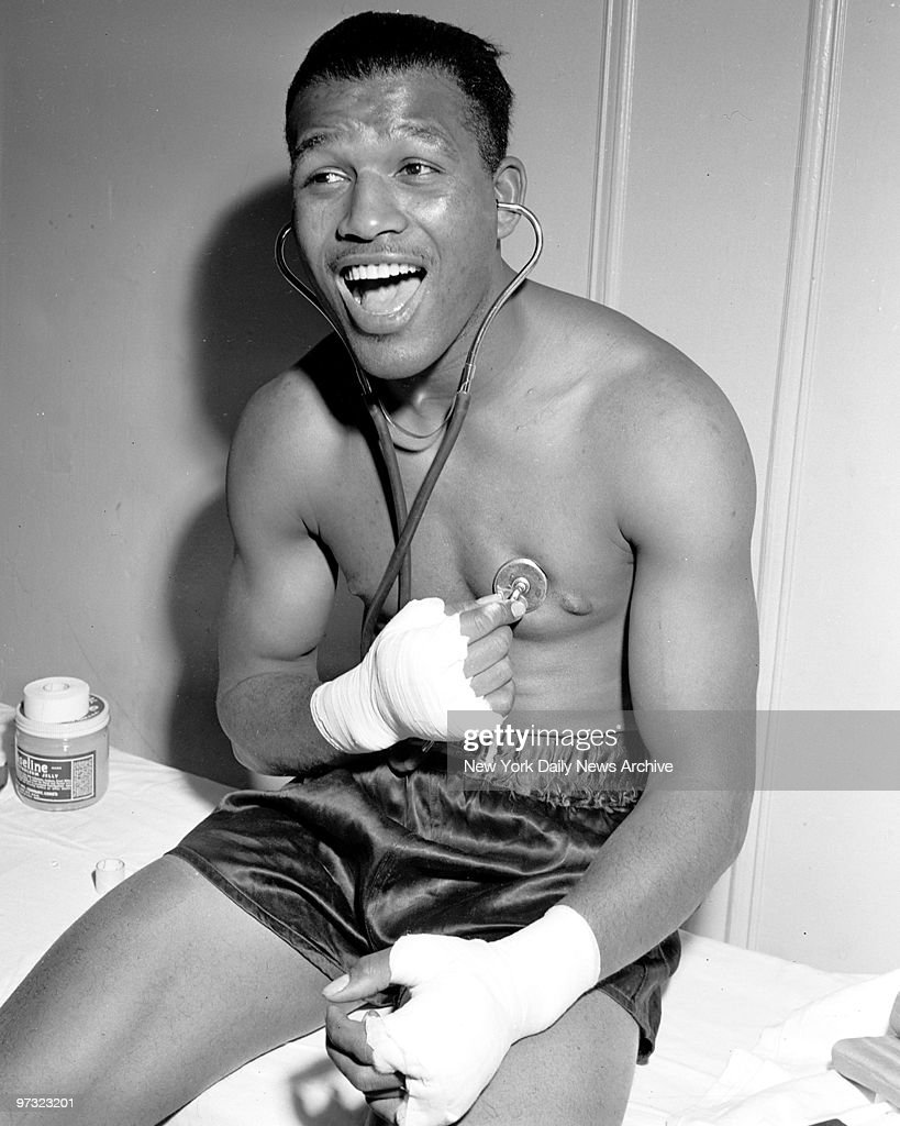 Sugar Ray Robinson likes what he hears at the Uptown Gym
