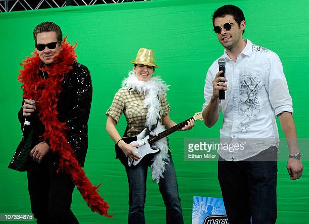 Sugar Ray singer Mark McGrath and contest winners Cari Shields of Ohio and Alex Balagna of Illinois perform with the music video game 'Rock Band 3'...