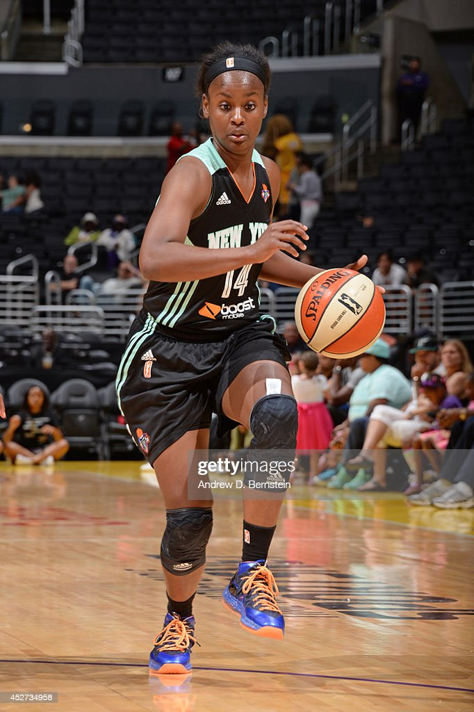 Sugar Rodgers #14 of the New York Liberty drives against the Los Angeles Sparks at STAPLES Center on July 23, 2014 in Los Angeles, California.