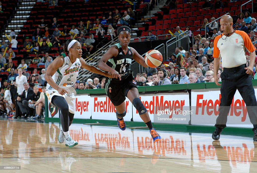 Sugar Rodgers #14 of the New York Liberty drives against the Seattle Storm on July 24,2014 at Key Arena in Seattle, Washington.