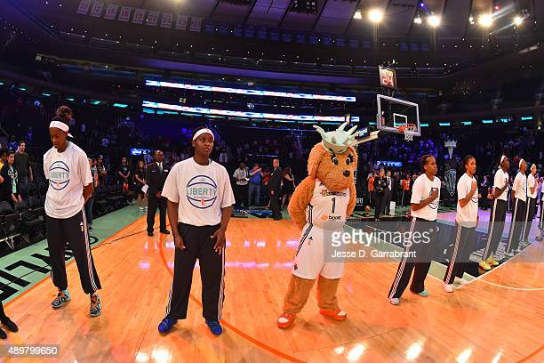 Sugar Rodgers of the New York Liberty during the national anthem before the game against the Indiana Fever in Game One of the WNBA Eastern Conference...