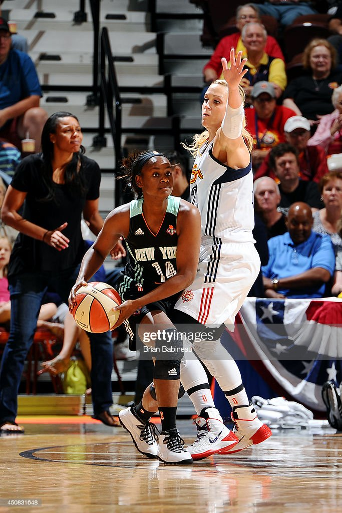 Sugar Rodgers of the New York Liberty handles the ball against Katie Douglas of the Connecticut Sun on June 15 2014 at the Mohegan Sun in Uncasville...