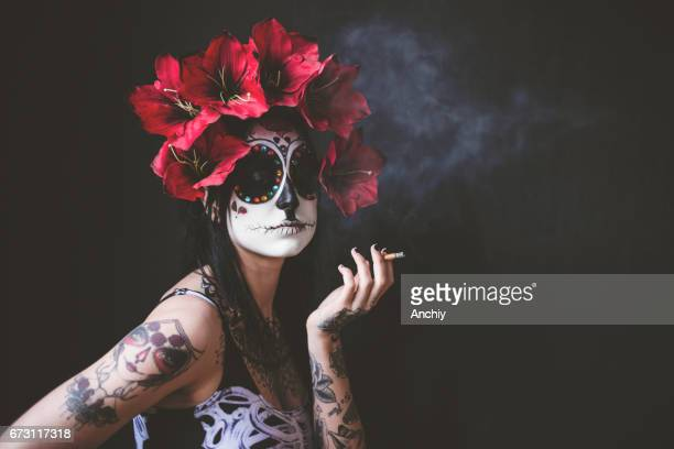 Sugar Skull beauty smoking cigarillos
