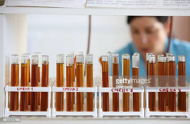 Sugar syrup sits in test tubes during analysis in the laboratory at the Zainsk sugar plant operated by ZAO Agrosila Group in Zainsk Russia on Friday...