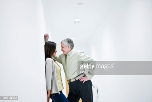 suggestive couple in corridor