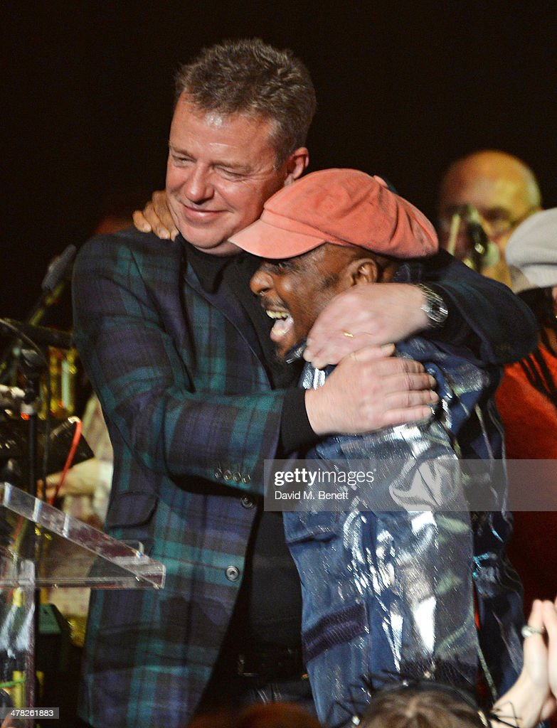 Suggs (L) and Jimmy Cliff perform at 'A Night of Reggae' hosted by Helena Bonham Carter for Save The Children UK at The Roundhouse on March 12, 2014 in London, England.