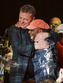Suggs and Jimmy Cliff perform at 'A Night of Reggae' hosted by Helena Bonham Carter for Save The Children UK at The Roundhouse on March 12 2014 in...