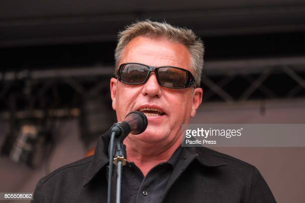 Suggs of Ska group Madness addresses the crowd Thousands of protesters march through London and rally in Parliament calling for a change in...