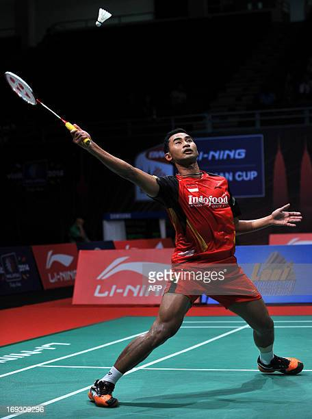 Sugiarto Tommy of Indonesia hits a return against Chen Long of China during their quaterfinal match at the 2013 Sudirman Cup world mixed team...