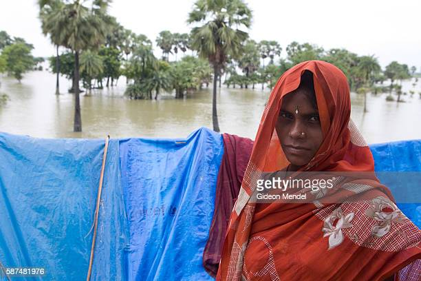 Sugua Devi in front of her makeshift plastic shelters set up on a road embankment in east Champaran She had to flee from their village of Dekha...