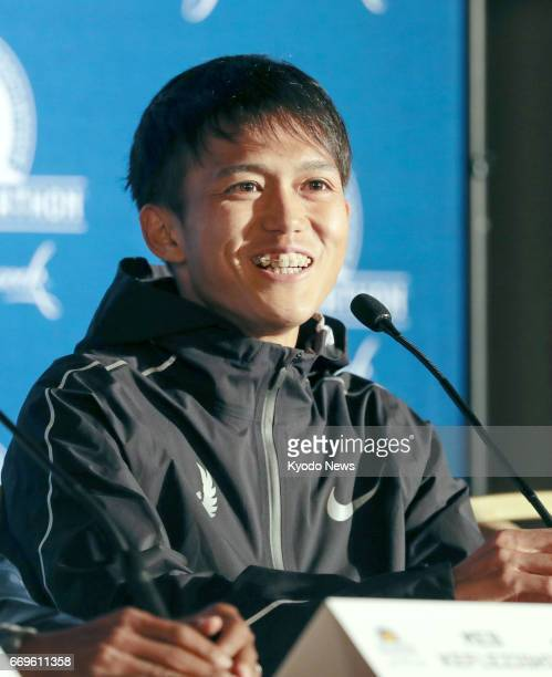 Suguru Osako of Japan attends a press conference in Boston on April 17 after finishing third in the men's race of the Boston Marathon in his marathon...