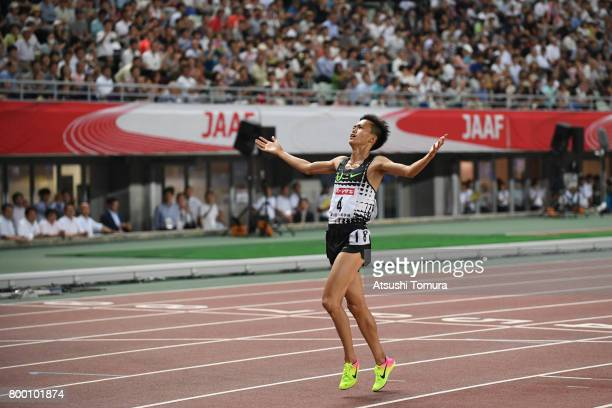 Suguru Osako of Japan celebrates after winning in the Men 10000m final during the 101st Japan National Championships at Yanmar Stadium Nagai on June...