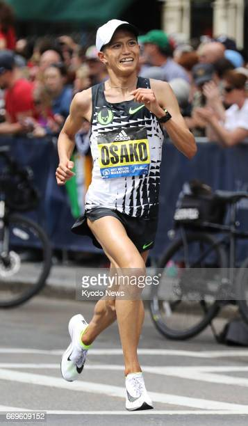 Suguru Osako of Japan competes in the Boston Marathon in Massachusetts on April 17 2017 Osako finished third in the men's race with a time of 2 hours...