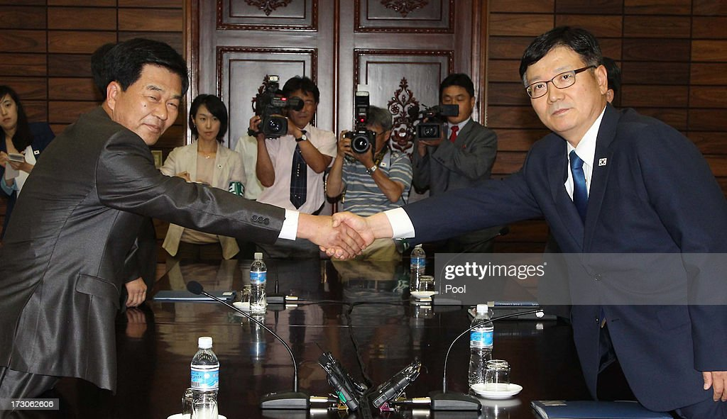 Suh Ho, the head of South Korea's working-level delegation (R) shakes hands with his North Korean counterpart Park Chol-Su during their meeting at Tongilgak, border village of Panmunjom on July 6, 2013 in North South Korea. The delegations met at the neutral border village of Panmunjom and began talks discussing the future of the Kaesong Industrial complex which was shut down three months ago amid high tensions between the two countries.