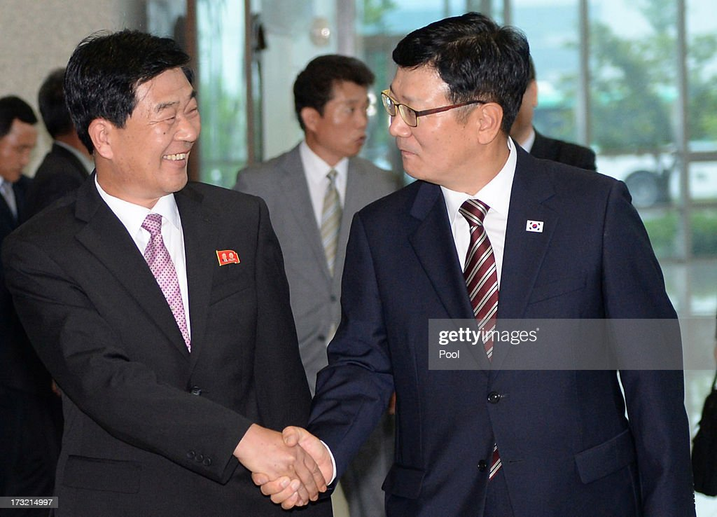 Suh Ho, the head of South Korea's working-level delegation (R), shakes hands with his North Korean counterpart Park Chol-Su (L) as they leave after meeting at Kaesong Industrial District Management Committee on July 10, 2013 in Kaesong, North Korea. Government officals and business leaders from North and South Korea will hold talks today to discuss resuming operations at the Kaesong Joint Industrial Park 10 kilometres north of the border. North Korea withdrew over 50,00 of it's staff from the factories owned by Seoul in April of this year, and South Korea removed managers in May, during the height of tensions between the two nations.