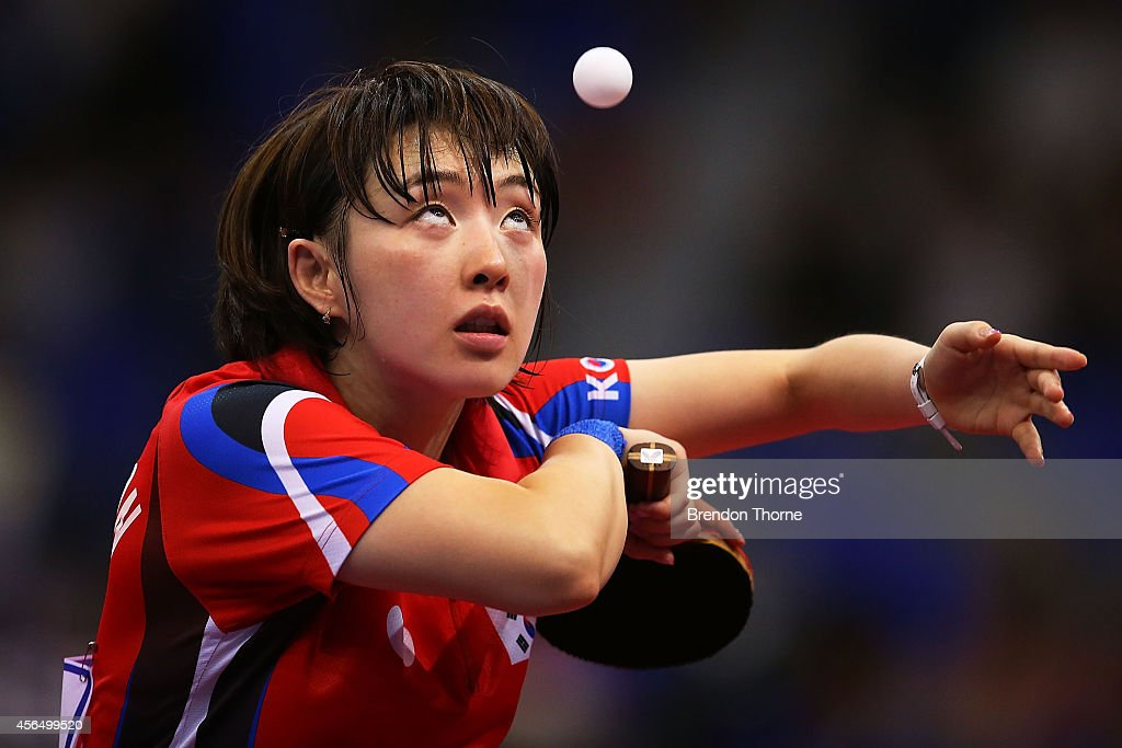 Suh Hyowon of South Korea serves in her Round of 16 Elimination Match against Ri Myongsun of North Korea during day thirteen of the 2014 Asian Games at Suwon Gymnasium on October 2, 2014 in Incheon, South Korea.