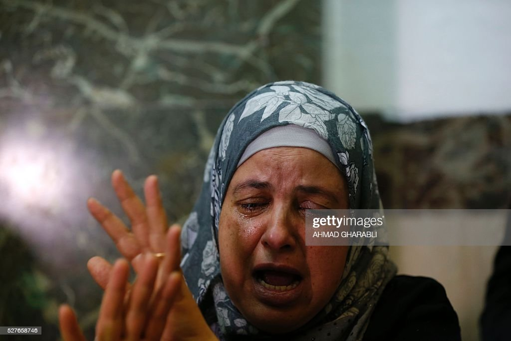 Suha, the mother of killed Palestinian teenager Mohammed Abu Khdeir, reacts at the district court in Jerusalem on May 3, 2016 as a life sentence is handed down to the ringleader of a Jewish gang who kidnapped, beat and burned alive her son in 2014. An Israeli court handed down a life sentence to the ringleader of a Jewish gang who kidnapped, beat and burned alive a Palestinian teenager in 2014. Yosef Haim Ben-David, 31, was sentenced for killing 16- year-old Mohammed Abu Khdeir, and was also given 20 years for other crimes. Abu Khdeir was kidnapped by Ben-David and two young accomplices from Israeli-annexed east Jerusalem on July 2, 2014 and beaten. His burned body was found hours later in a forest in the western part of the city. / AFP / AHMAD