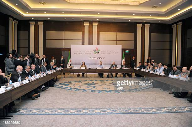 Suheir Attasi Syrian opposition's National Coalition chief Ahmed Moaz alKhatib and Mostafa Sabbahand George Sebra attend Syria's opposition coalition...