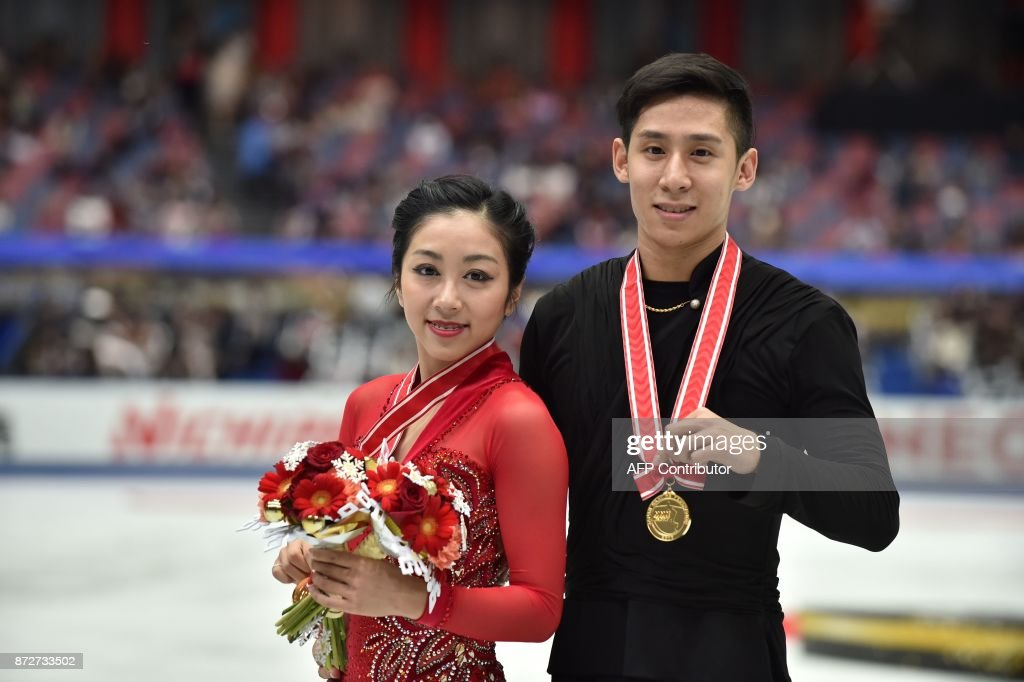 Вэньцзин Суй - Цун Хань / Wenjing SUI - Cong HAN CHN - Страница 11 Sui-wenjing-and-han-cong-of-china-pose-following-their-win-in-the-picture-id872733502