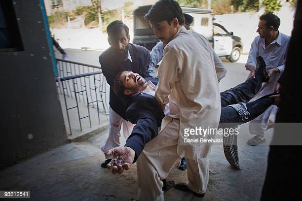 A suicide bomb blast victim is rushed in for emergency treatment at the Lady Reading Hospital on November 19 2009 in Peshawar Pakistan A suicide...