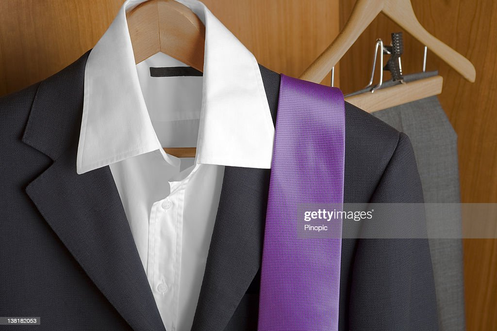 Suit and tie inside of a closet