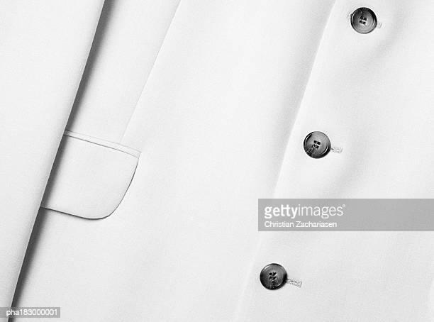 Suit buttons, close-up, b&w