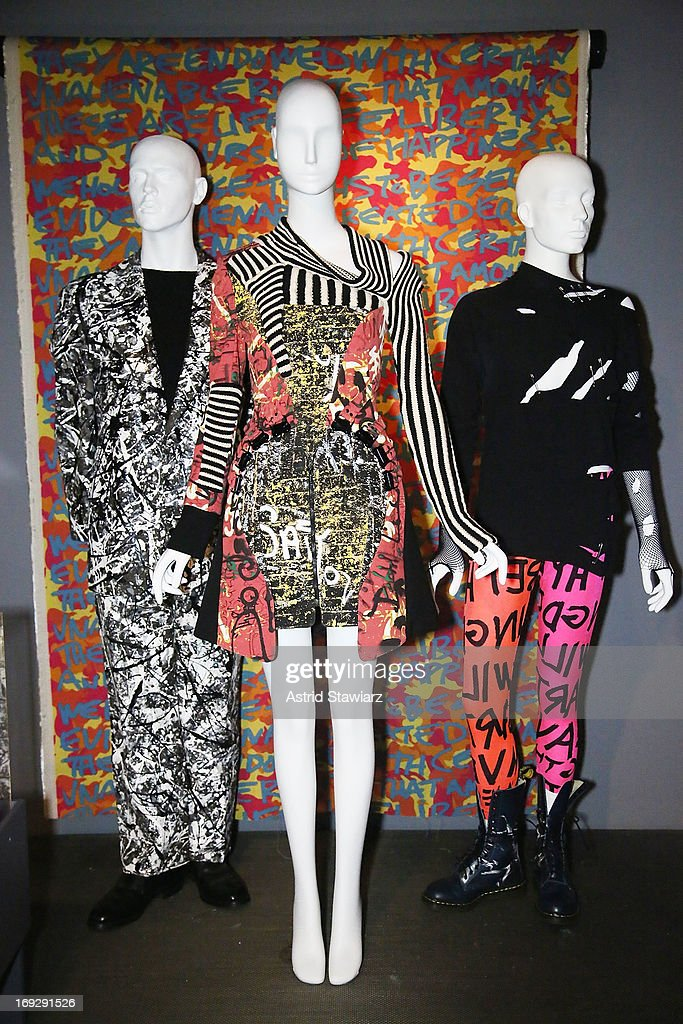 A suit by artist Mike Bidlo, a dress by Nicolas Ghesquiere for Balenciaga and leggings by Stephen Sprouse are shown at the RetroSpective Press Preview at The Museum at FIT on May 22, 2013 in New York City.